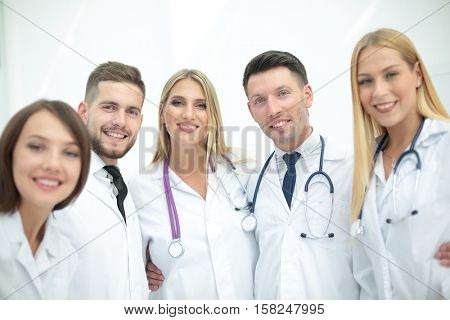 Smiling Team Of Doctors  At Hospital Making Selfie