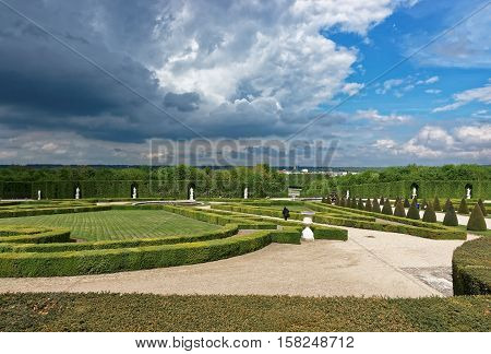 Paris France - May 5 2012: Orangerie Park of Versailles in Paris in France. People on the background.