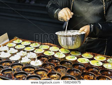 Person Selling Food In Myeongdong Open Street Market In Seoul