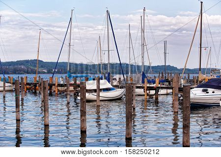 Pier With Boats On Reichenau Island And Lake Constance