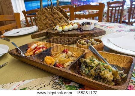 various entries on a table cheese tuna chicken jam shrimps mussel little fried sardine