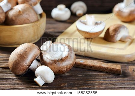 Portobello champignon on a kitchen wooden table close-up