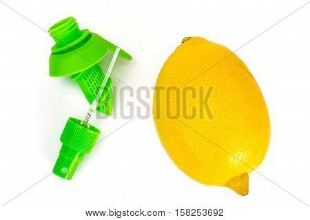 Citrus juice sprayer and lemon. Studio Photo