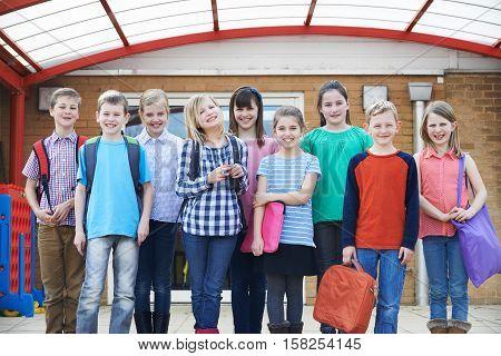 Portrait Of Pupils Standing In School Playground