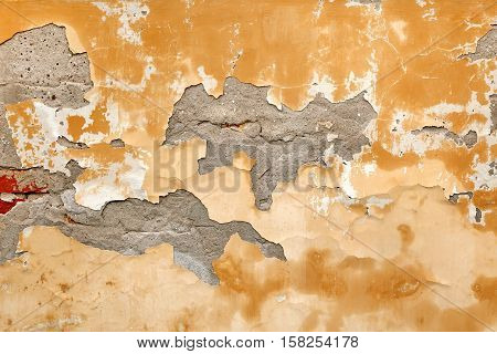 Old Brick Wall With Damaged Shabby Yellow Plaster Layer Background. Grunge Brickwall With Rundown Stucco Horizontal Texture. Lime Wash Distressed Vintage Stonewall Chipped Stonewall Surface