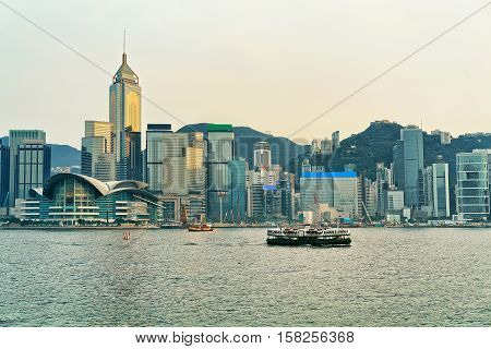 Star Ferry At The Victoria Harbor In Hong Kong At Sunset
