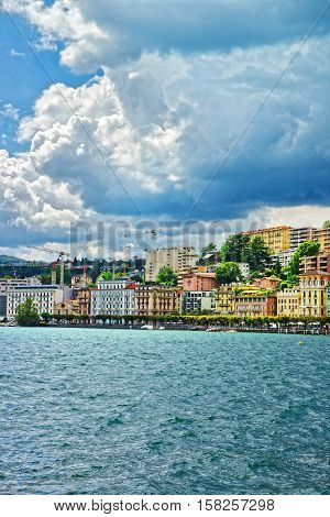 Swiss Houses At Lake Lugano And Mountains In Ticino Switzerland