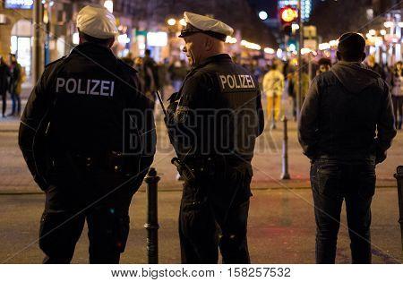 Frankfurt am Main, Hessen, Germany - November 21, 2016: Policemen walking near Frankfurt am Main Hauptbahnhof at night