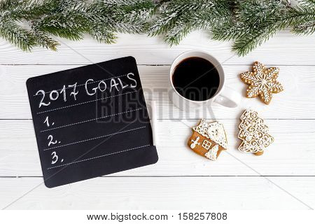 board with goals for new 2017 year on wooden background top view