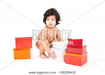 baby asian boy in diaper with gift box