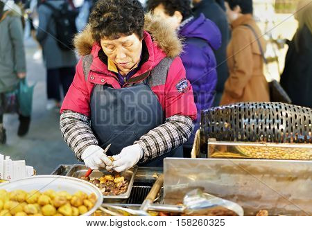 Woman Selling Food At Myeongdong Street Market In Seoul