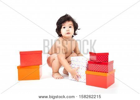 baby asian boy in diaper with boxes.