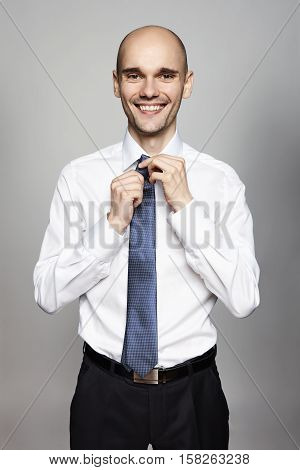 Man Fixing His Tie