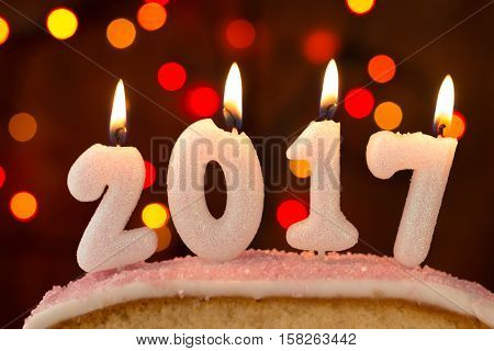 2017 Lit Candles Burning On Top Of A Cake