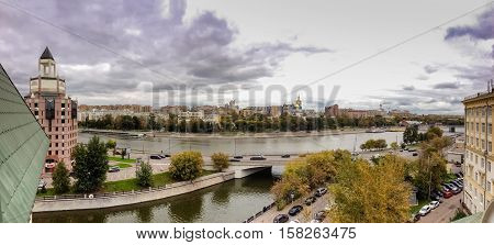 MOSCOW, RUSSIA - SEPT 27, 2016: Panoramic view to Moscow river Shluzovaja Embankment at spit of Bolotny island and Vodotvodni Canal in Moscow, Russia on Sept 27, 2016.