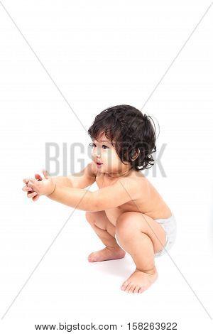 lovely baby asian boy in white diaper