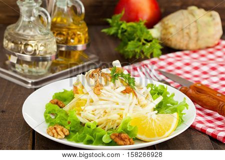 Waldorf salad made of fresh apples, celery and walnuts,farm-style