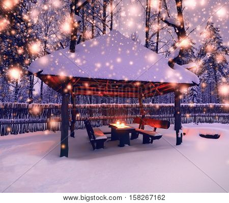 Decorative lights at christmas night. Xmas lights on snowy background. Snowflakes at snowy night.