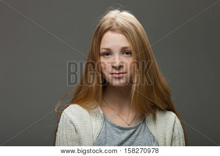Human Face Expressions And Emotions. Portrait Of Young Adorable Redhead Woman In Cozy Shirt Looking