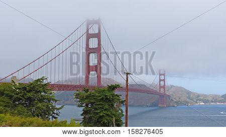 The Golden Gate Bridge in San Francisco, famous building, cloudy sky