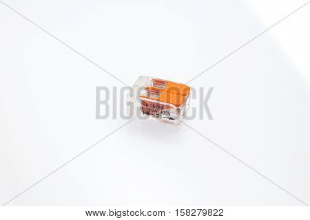Compact splicing connector isolated on white background. poster