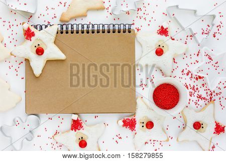 Funny Santa Claus cookie - Christmas and New Year treats for kids homemade holiday cookies Xmas holiday baking background blank space for text menu or recipe