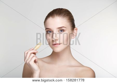 Beauty portrait young woman healthy skin care health white background smile healthcare treatment copy space black mask salve close up