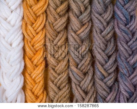 Braided wool yarn swatches colored by henna and indigo mix in 1:0 3:1 1:1 1:3 0:1 proportions and control white sample