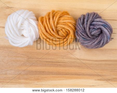 Wool bun swatches colored by henna and indigo and control white sample
