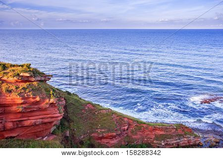 Red Layered Cliffs Of Scotland's South-east Coast