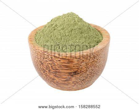 Indigo indigofera tinctoria powder in the wooden bowl isolated on white