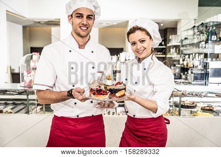 Bakery shop staff portrait. Family business about food