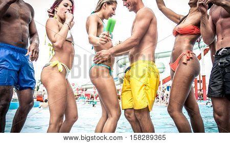 Pool party dancing fun. group having fun near swimming pool
