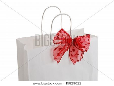 Closeup Of White Paper Gift Bag With Red Bow