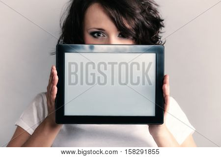 Technology. Sexy girl young attractive woman in summer clothes showing copy space on tablet touchpad.