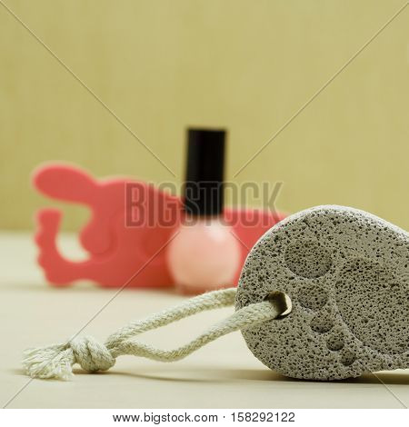 Feet nails care. Pedicure accessories set tools: toe separators varnish and stone pumice with foot print
