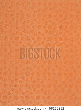Orange cleaning cellulose sponge texture and background