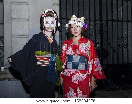 OAXACA, OAXACA, MEXICO - NOVEMBER 1, 2016: Geisha girls at traditional day of the dead parade in Oaxaca, Oaxaca, Mexico