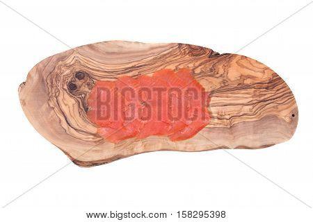 Smoked wild pacific sockeye salmon on olive wood cutting board