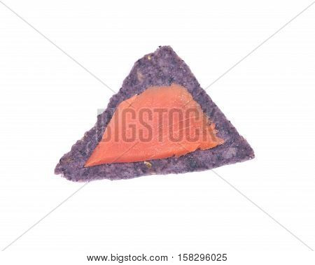 Smoked wild pacific sockeye salmon on blue corn tortilla chips isolated on white background