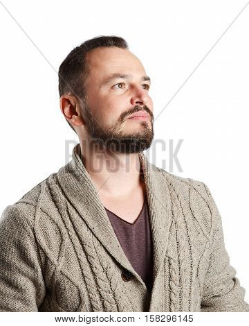 Handsome beautiful happy bearded man hipster nerd geek in knitted jacket and black jeans isolated on white background