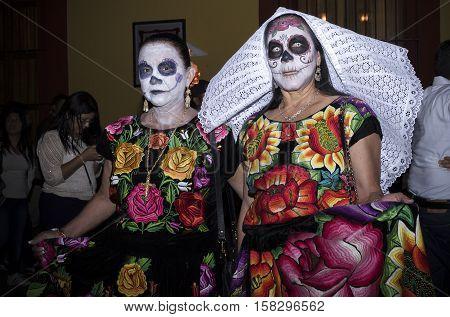 OAXACA, OAXACA, MEXICO - NOVEMBER 1, 2016: Catrinas as tehuanas costume at traditional day of the dead parade in Oaxaca, Oaxaca, Mexico
