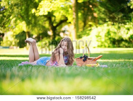 Beautiful Girl Having A Picnic
