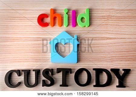 Words CHILD CUSTODY on wooden background, top view