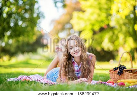 Beautiful Girl Having A Picnic In Park.