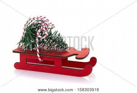 Red Wooden sled with Chrisstmas Tree on a white background  with copy space