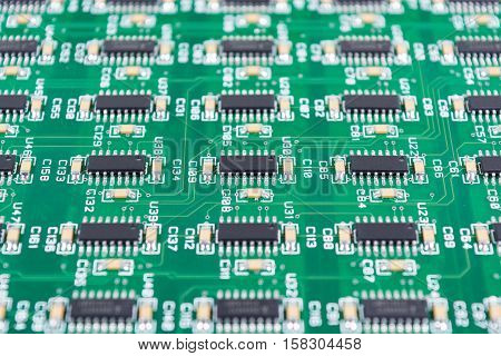 Closeup of electronic circuit board with electronic components background