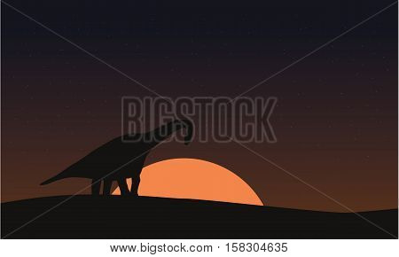 Silhouette of brachiosaurus on hill scenery vector