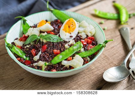 Thai Riceberry with Boiled egg and Snow pea salad
