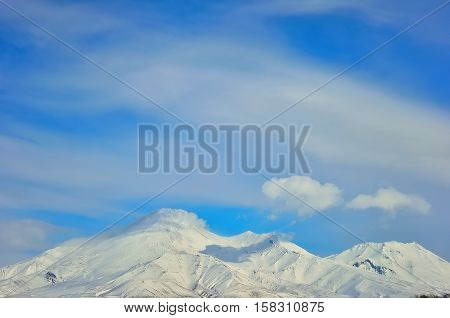 Volcano with snow in winter day in Russia on Kamchatka
